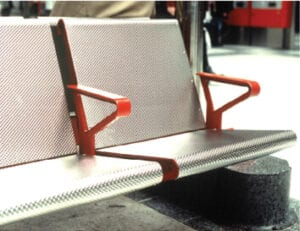 Bus station seat with colourful anodised aluminium arms.